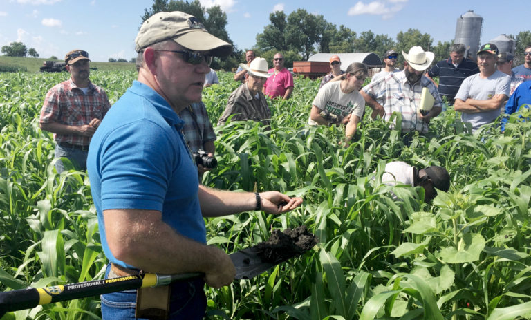 Allen Williams in field with shovel during Dirt Rich workshops
